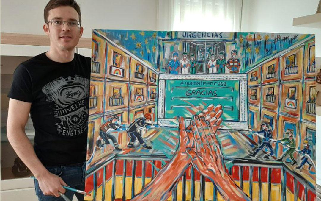El artista Ignacio Pérez con el cuadro que ha pintado