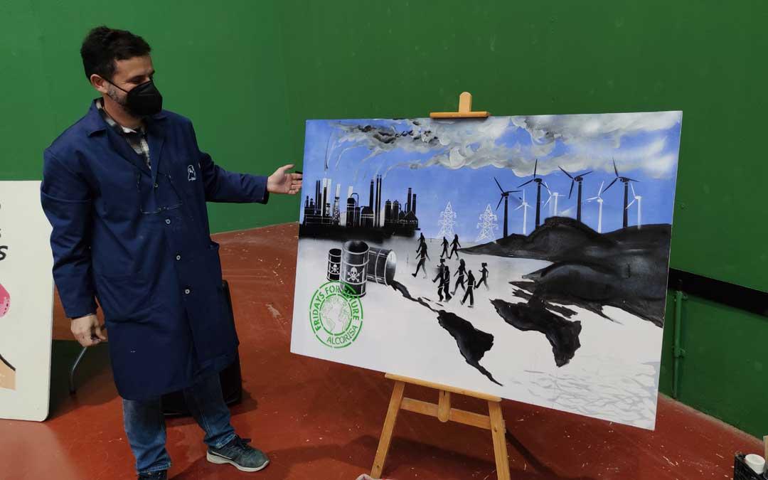 Joaquin Macipe pintando un cuadro sobre la emergencia climática / A. Gracia